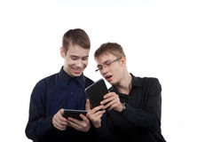 Teen couple playing on the Tablet PC Royalty Free Stock Photo