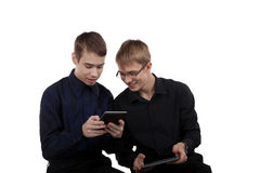 Teen couple studying on a Tablet PC Royalty Free Stock Images