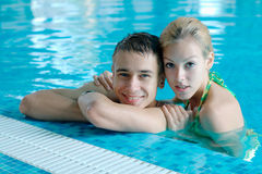 Teen couple at the swimming pool. Portrait of teen couple at the swimming pool Stock Photo