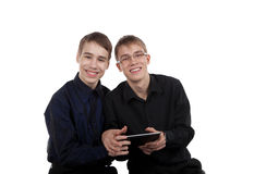 Teen couple with tablet computer Royalty Free Stock Photos