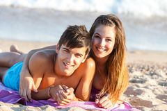 Teen couple together on beach. Royalty Free Stock Photo