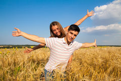 Teen couple on the wheat field. Inloved teen couple having fun on the wheat field royalty free stock photos