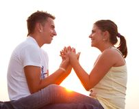 Teen couple2. Lovely couple holding hands at sunset Royalty Free Stock Photo