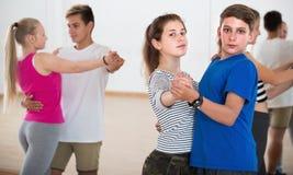 Teen  couples dancing partner dance. In classroom Stock Photo
