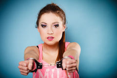 Teen crime - teenager girl in handcuffs Stock Images