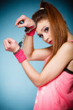 Teen crime - teenager girl in handcuffs Stock Photography