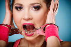 Teen crime - teenager girl in handcuffs. Teen crime, arrest and jail - Criminal teenager girl prisoner woman in handcuffs blue background stock images