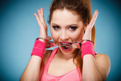 Teen crime - teenager girl in handcuffs Royalty Free Stock Images