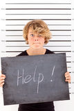 Teen crying for help. Teen boy crying for help when in troble with law Royalty Free Stock Images