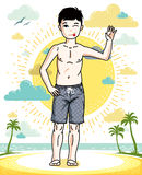 Teen cute little boy standing in colorful stylish beach shorts. Stock Images
