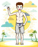 Teen cute little boy standing in colorful stylish beach shorts. Royalty Free Stock Photography