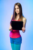 Teen cutie with tablet for copy space. Royalty Free Stock Photos