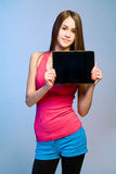 Teen cutie with tablet for copy space. Stock Photo