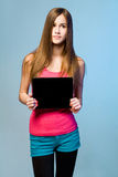 Teen cutie with tablet for copy space. Royalty Free Stock Image