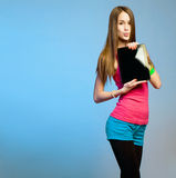 Teen cutie with tablet for copy space. Royalty Free Stock Images