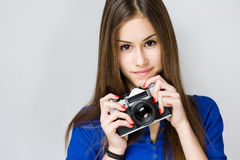 Teen cutie with vintage camera. Stock Photos