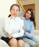 Teen daughter asking for forgiveness from her mother. After conflict. Focus on mature woman stock images