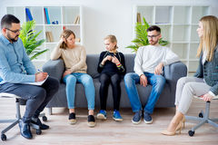 Teen daughter in family therapy. A rebellious teen daughter in family therapy Stock Images