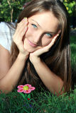 Teen with decorative flower Royalty Free Stock Photos