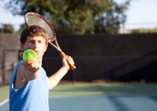 Teen Determination. Teenager playing Tennis with determination royalty free stock photos