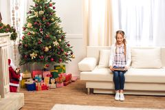 Teen with digital tablet at christmastime Stock Images