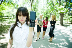 Teen displaying cell phone Stock Photo
