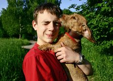 Teen and dog Royalty Free Stock Photos