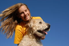 Teen with dog. Teen with her wheaten terrier dog Royalty Free Stock Images
