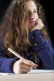 Teen doing her homework Stock Photography