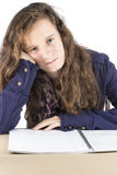 Teen doing her homework. A teenage girl doing her homework at a table Royalty Free Stock Photo