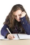 Teen doing her homework Royalty Free Stock Photos