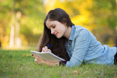 Teen Doing Homework Outside Royalty Free Stock Image