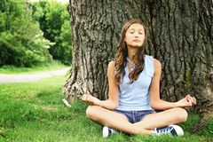 Teen doing yoga Stock Photo
