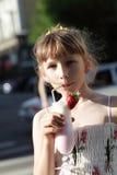 Teen drinks milk shake outdoor Stock Image