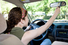 Teen Driver Adjusting Rearview Mirror Royalty Free Stock Photo