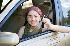 Teen Driver with Car Keys. Cute teen girl excited to have the car keys Stock Photo