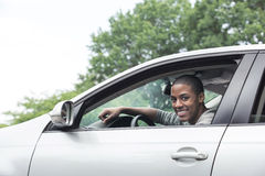Teen driver with car. Teenager driving car on street stock photo