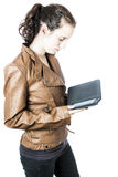 Teen with e-reader. A teen with an e-reader in her hand Royalty Free Stock Image