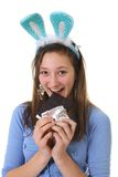 Teen eating chocolate Royalty Free Stock Photos