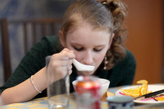 Teen eating soup Royalty Free Stock Photos