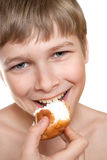 Teen eats cake. Stock Images