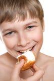 Teen eats cake. Stock Images