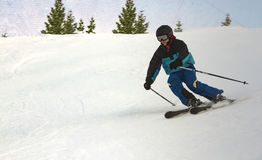 Teen enjoys competitive downhill skiing Stock Images