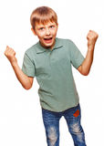 Teen excited happy teenage boy shows his hand so Royalty Free Stock Photography