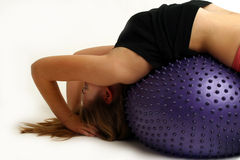 Teen on exercise ball. Girl sorking on exercise ball Royalty Free Stock Photo