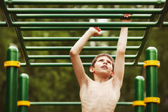 Teen exercise on the playground Stock Images