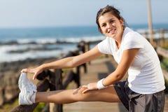 Teen exercising beach stock photography