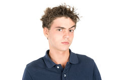 Teen faces. Angry teenage boy making faces isolated in white Stock Photo
