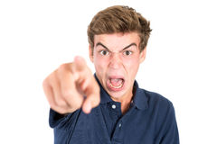 Teen faces. Angry teenage boy making faces isolated in white Royalty Free Stock Photos