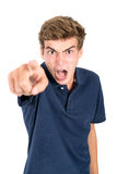 Teen faces. Angry teenage boy making faces isolated in white Stock Image
